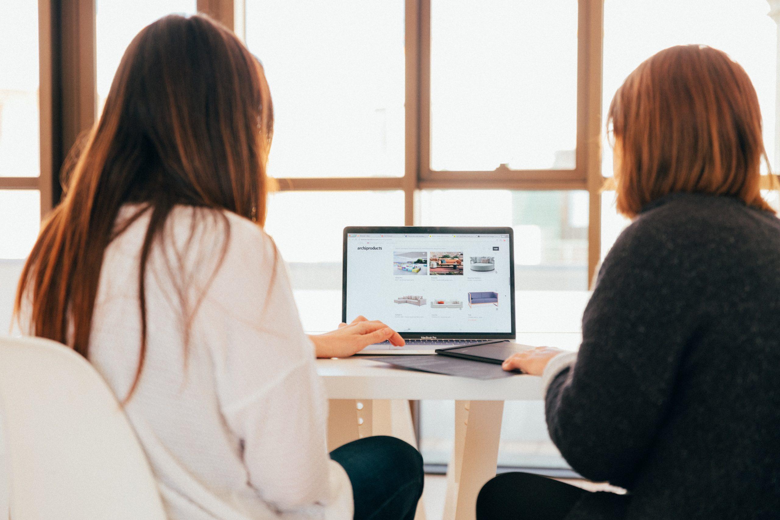 two women reviewing portfolios